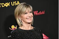 """<p>Newton-John was diagnosed with breast cancer in 1992 and again with cancer in her shoulder in 2013. In an interview with <a href=""""http://www.everydayhealth.com/breast-cancer/mylife/olivia-newton-john/questions.aspx"""" rel=""""nofollow noopener"""" target=""""_blank"""" data-ylk=""""slk:Everyday Health"""" class=""""link rapid-noclick-resp""""><em>Everyday Health</em></a> in 2008 about her first time battling the disease, she said, """"My family and friends were definitely the key to my recovery."""" She has since opened the Olivia Newton-John Cancer & Wellness Centre in Melbourne, Australia. <br> </p>"""