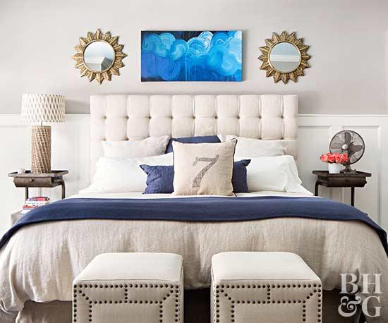 white bedroom with sun mirrors