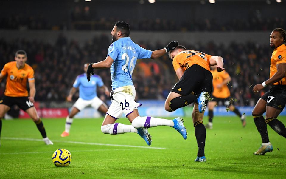 Riyad Mahrez of Manchester City is tripped by Leander Dendoncker of Wolverhampton Wanderers - Getty Images