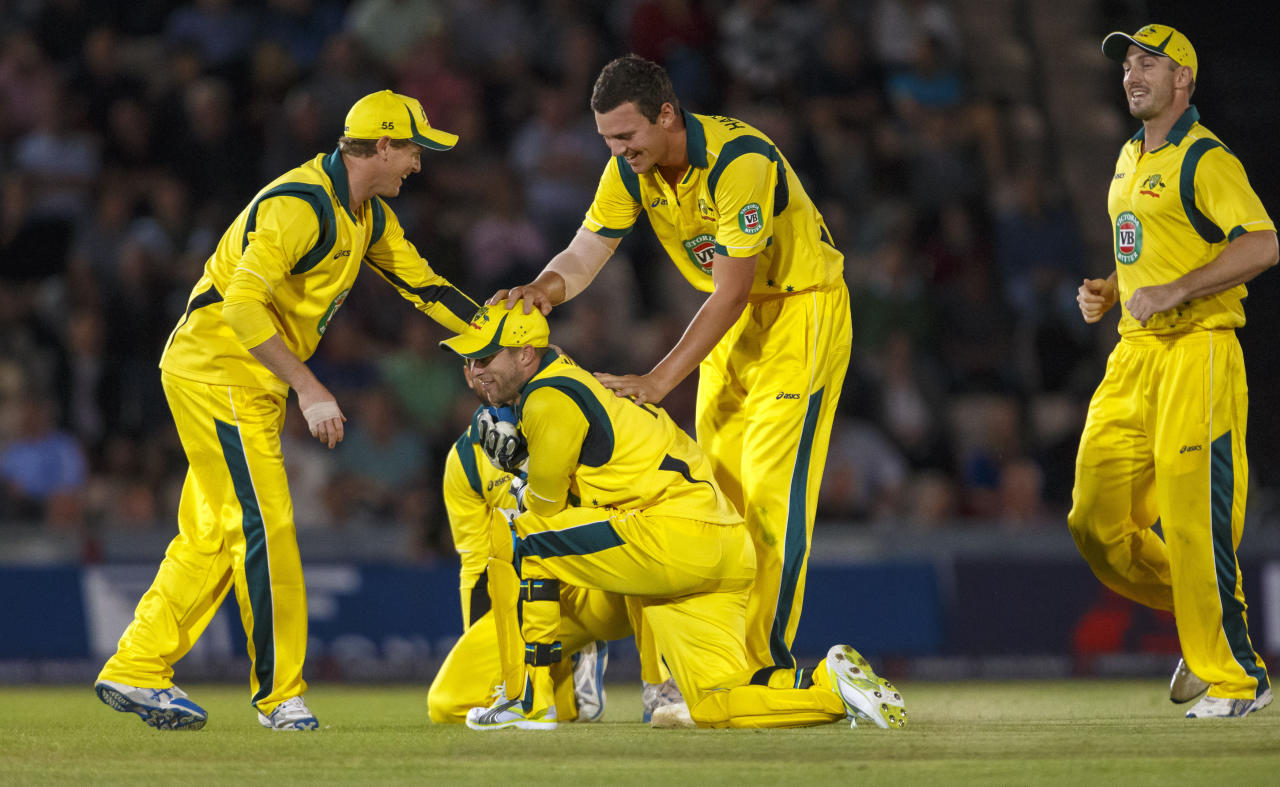 Australia congratulate Matthew Wade after catching England's Alex Hales during the International Twenty20 match at the Ageas Bowl, Southampton.