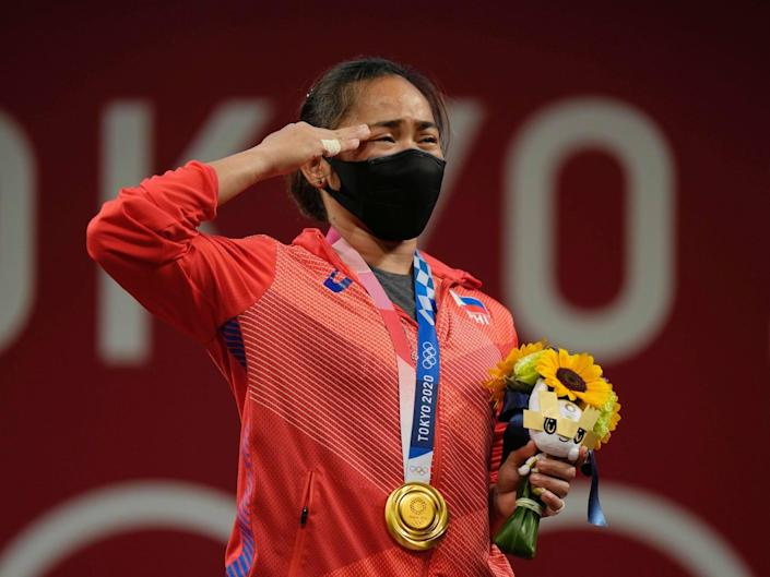 Hidilyn Diaz salutes during the Tokyo Olympics medal ceremony.