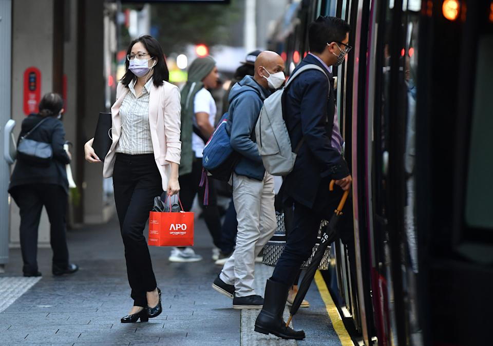 Passengers wearing face masks use a light rail service in Sydney on Thursday. Source: AAP