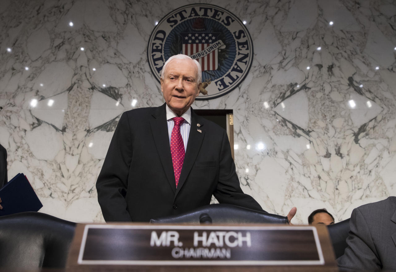 "<p> In this Nov. 13, 2017, photo, Senate Finance Committee Chairman Orrin Hatch, R-Utah, arrives as the tax-writing panel begins work on overhauling the nation's tax code, on Capitol Hill in Washington. Millions would forgo coverage if Congress repeals the unpopular requirement that Americans get health insurance, gambling with their own wellbeing and boosting premiums for others. Just as important, the drive by GOP senators to undo ""Obamacare's"" coverage requirement fits in with Trump administration efforts to write regulations allowing for plans with limited benefits and lower premiums. (AP Photo/J. Scott Applewhite, File) </p>"