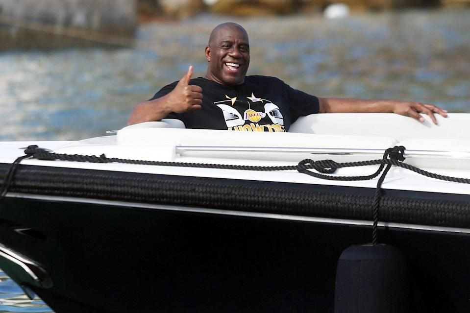 <p>Magic Johnson smiles as he soaks up the sun on a superyacht in Croatia on Wednesday.</p>