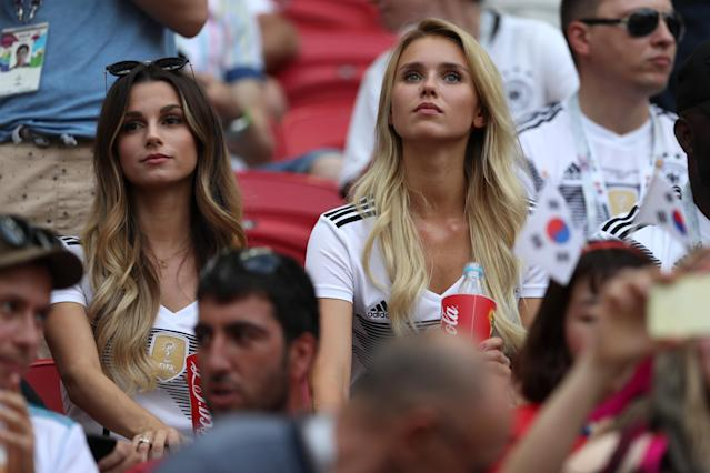 <p>Matthias Ginter of Germany's wife, Christina Ginter, and Marco Reus of Germany's girlfriend Scarlett Gartmann look on during the 2018 FIFA World Cup Russia group F match between Korea Republic and Germany at Kazan Arena on June 27, 2018 in Kazan, Russia. (Photo by Lars Baron – FIFA/FIFA via Getty Images) </p>
