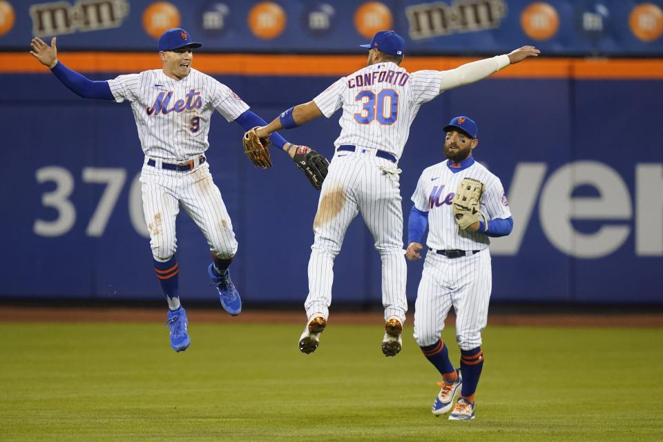 New York Mets' Brandon Nimmo (9), Michael Conforto (30) and Kevin Pillar (11) celebrates after a baseball game against the Philadelphia Phillies Wednesday, April 14, 2021, in New York. The Mets won 5-1. (AP Photo/Frank Franklin II)