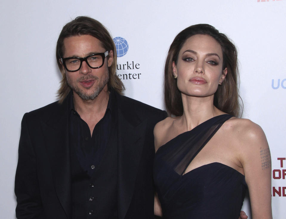 "August 11th 2020 - Angelina Jolie seeks the removal of a private judge in her ongoing divorce case against former husband Brad Pitt. - File Photo by: zz/KGC-11/STAR MAX/IPx 2011 12/8/11 Brad Pitt and Angelina Jolie at the premiere of ""In The Land of Blood and Honey"". (Los Angeles, CA)"