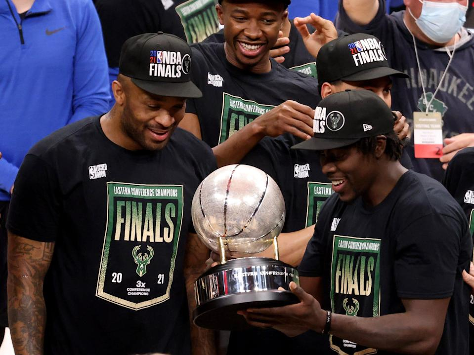 The acquisition of forward P.J. Tucker (left) at the trade deadline and guard Jrue Holiday during the offseason helped the Bucks reach their first NBA Finals since 1974.