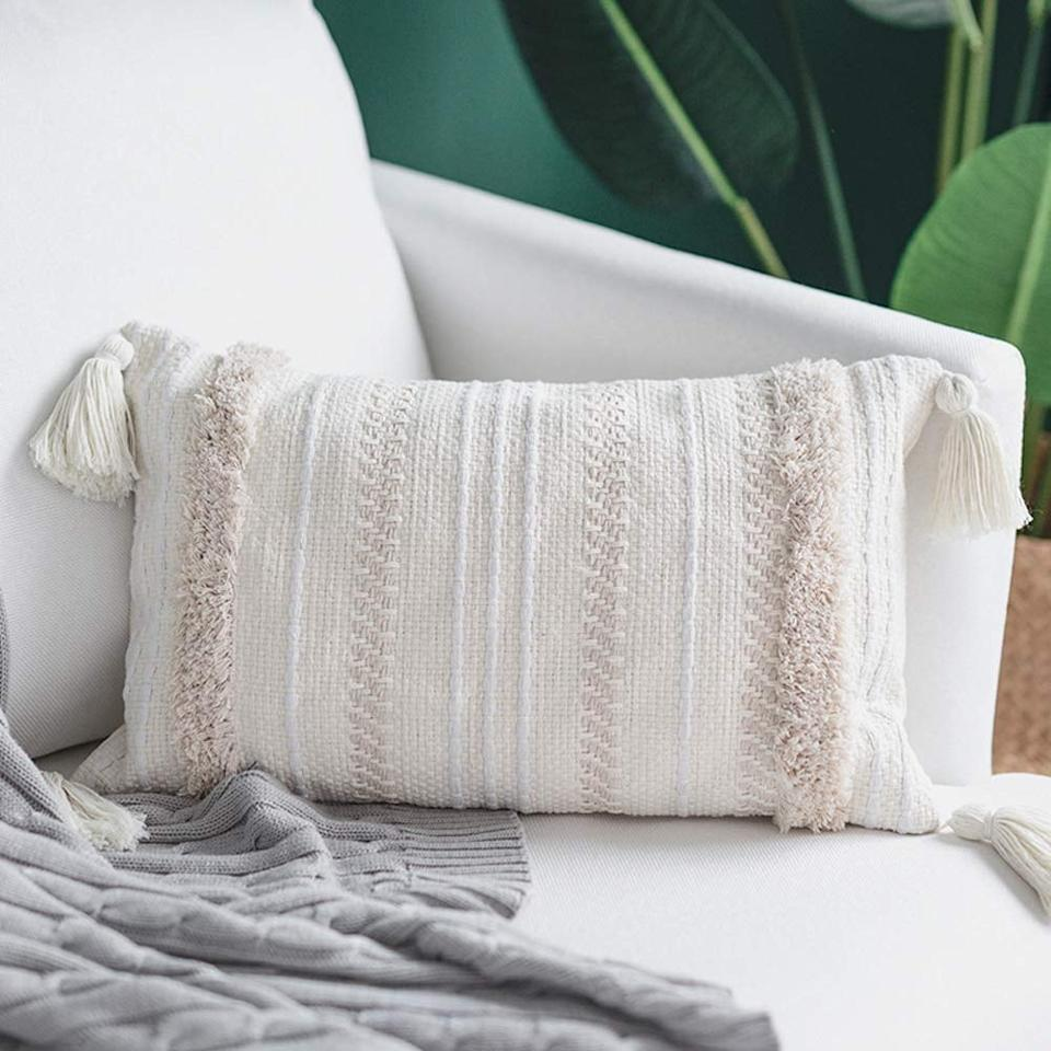 """<p>Prefer a minimal design? Go with these <product href=""""https://www.amazon.com/blue-page-Decorative-Bedroom-Rectangle/dp/B07NJNSXK7/ref=sr_1_11?keywords=throw+pillows&amp;qid=1572454427&amp;sr=8-11"""" target=""""_blank"""" class=""""ga-track"""" data-ga-category=""""Related"""" data-ga-label=""""https://www.amazon.com/blue-page-Decorative-Bedroom-Rectangle/dp/B07NJNSXK7/ref=sr_1_11?keywords=throw+pillows&amp;qid=1572454427&amp;sr=8-11"""" data-ga-action=""""In-Line Links"""">Blue Page Lumbar Small Decorative Throw Pillow Covers</product> ($15).</p>"""