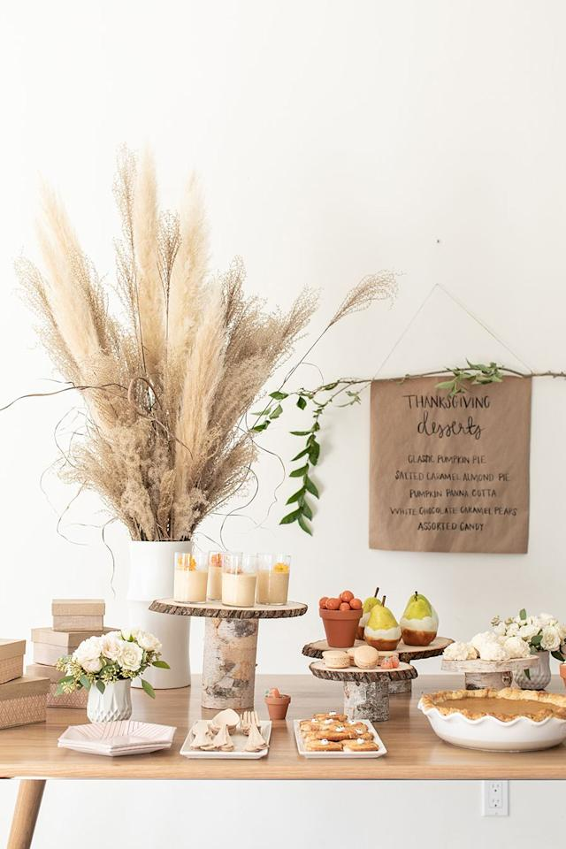 <p>Fluffy dried florals like pampas grass look beautiful on a buffet table or the grand dining table (and throughout the rest of the home and even the buffet table as Sugar and Charm did here). <em>And </em>they'll last longer than fresh flowers. <em></em></p>