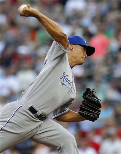 Kansas City Royals starting pitcher Jeremy Guthrie (11) throws against the Minnesota Twins during the first inning of a baseball game, Thursday, June 27, 2013, in Minneapolis. (AP Photo/Genevieve Ross)