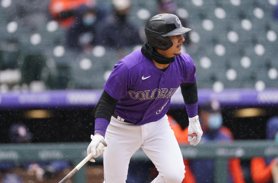 Colorado Rockies' Dom Nunez follows the flight of his RBI-single off Houston Astros starting pitcher Jose Urquidy in the second inning of a baseball game Wednesday, April 21, 2021, in Denver. (AP Photo/David Zalubowski)