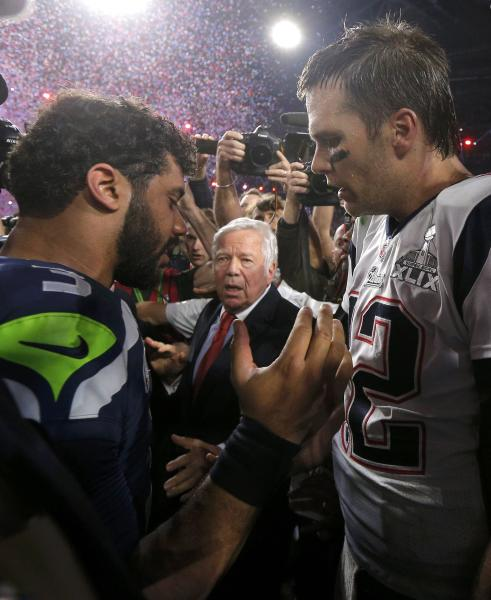 New England Patriots quarterback Brady greets Seattle Seahawks quarterback Wilson after the Patriots defeated the Seahawks in the NFL Super Bowl XLIX football game in Glendale