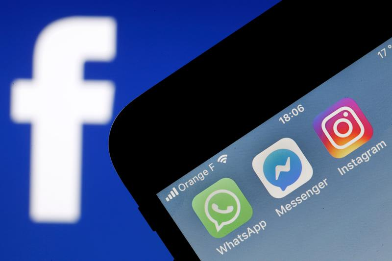 PARIS, FRANCE - JANUARY 28: In this photo illustration, the logos of the messaging applications, WhatsApp, Messenger and Instagram are displayed on the screen of an Apple iPhone in front of a computer screen displaying a Facebook logo on January 28, 2019 in Paris, France. The big new project of Mark Zuckerberg, founder of social network Facebook is to unify all its messaging applications according to the New York Times. So all the applications of Facebook, Messenger, Instagram and WhatsApp, could work together, the exchanged messages would be encrypted as they are currently on WhatsApp. 'We are working to ensure that more of our messaging is encrypted end-to-end and we are thinking of ways to make it easier to communicate with family and friends via all networks,' said a Facebook spokesman, confirming news reports from New York Times. Facebook's three messaging services each claim more than one billion users worldwide. (Photo by Chesnot/Getty Images)