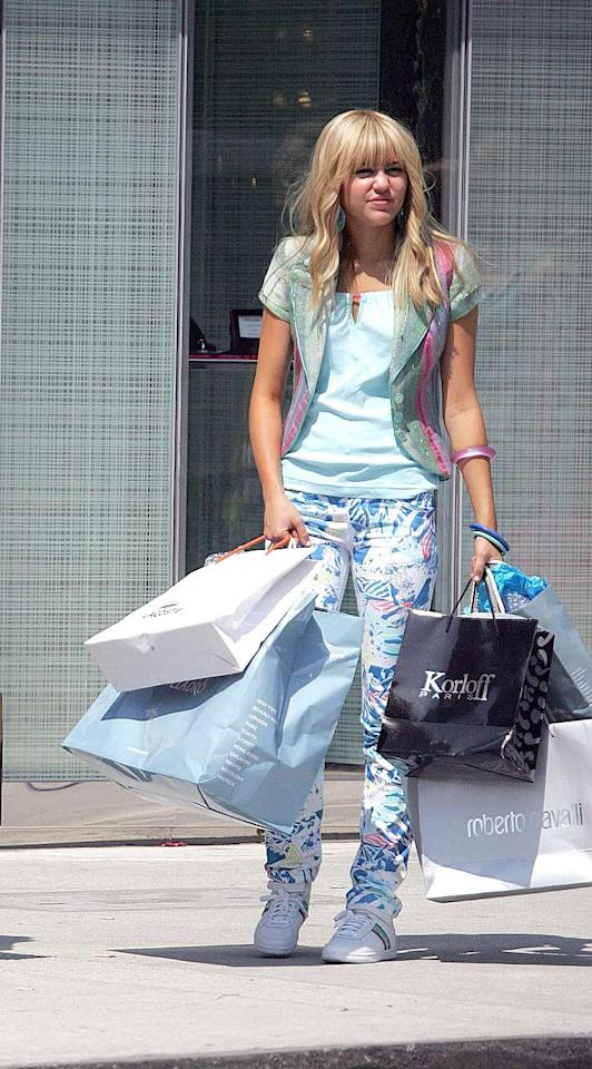 """Thank goodness Miley was spotted sporting this '80s-inspired outfit while filming scenes for the upcoming """"Hannah Montana"""" film. Otherwise, we'd never be able to forgive her. David Kaminski/<a href=""""http://www.splashnewsonline.com"""" target=""""new"""">Splash News</a> - July 14, 2008"""