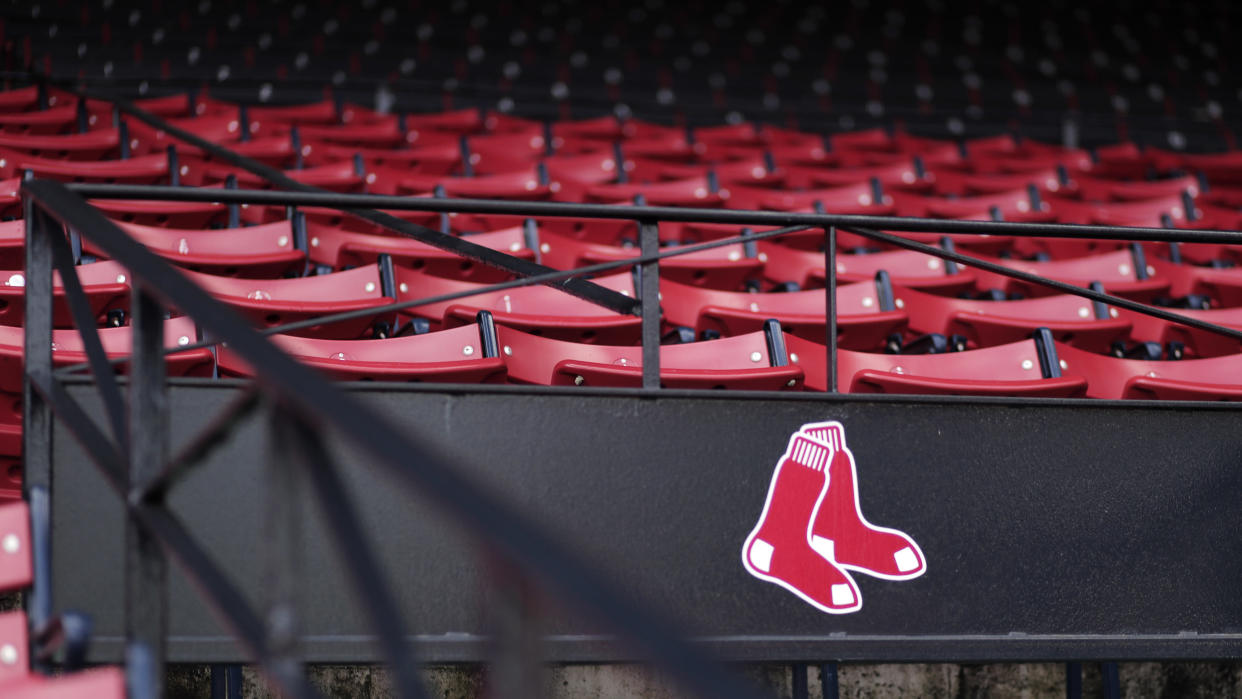 Red Sox logo with empty seats in the background.