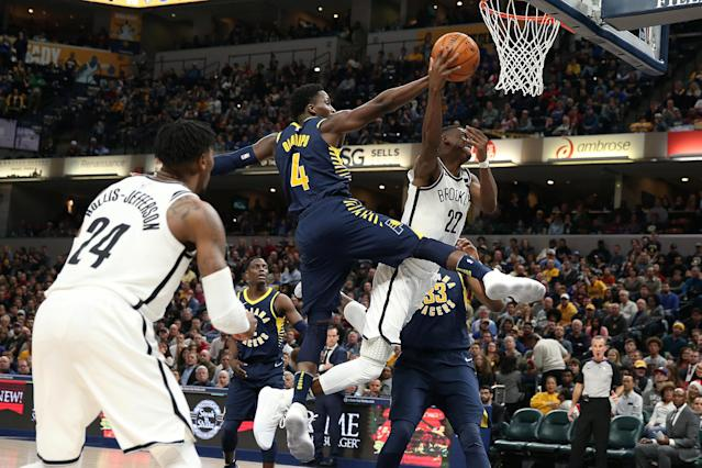 Dec 23, 2017; Indianapolis, IN, USA; Brooklyn Nets forward Caris LeVert (22) takes a shot and is fouled by Indiana Pacers guard Victor Oladipo (4) during the 4th quarter at Bankers Life Fieldhouse. Mandatory Credit: Brian Spurlock-USA TODAY Sports TPX IMAGES OF THE DAY