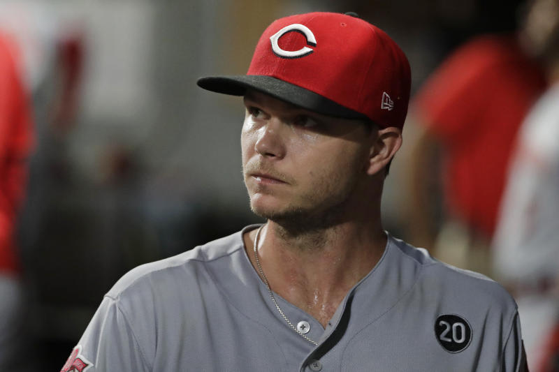 Cincinnati Reds starting pitcher Sonny Gray reacts in the dugout after he was pulled from a baseball game against the Seattle Mariners during the seventh inning Wednesday, Sept. 11, 2019, in Seattle. (AP Photo/Ted S. Warren)