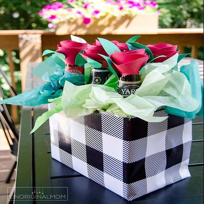 """<p>A colorful way to gift him exactly what he needs for the next time he wants to sit back and relax in his man cave.</p><p><em>Get the tutorial at <a href=""""https://www.unoriginalmom.com/beer-bouquet-tutorial-beer-gift-idea-for-men/"""" rel=""""nofollow noopener"""" target=""""_blank"""" data-ylk=""""slk:Unoriginal Mom"""" class=""""link rapid-noclick-resp"""">Unoriginal Mom</a>.</em></p><p><strong>RELATED:</strong> <a href=""""https://www.womansday.com/life/g3235/beer-gifts/"""" rel=""""nofollow noopener"""" target=""""_blank"""" data-ylk=""""slk:35 Best Beer Gifts to Give Dad for Father's Day"""" class=""""link rapid-noclick-resp"""">35 Best Beer Gifts to Give Dad for Father's Day</a><br></p>"""