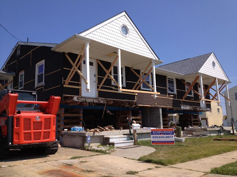This Aug. 2013 photo provided by L & R Resources, LLC shows Eileen Benner's Atlantic City home in the process of being elevated after it suffered severe flood damage during Oct. 2012 Superstorm Sandy, in New Jersey. Roderick Scott of L&R Resources in Mandeville, La., says he recommends that homes be lifted 1 or 2 feet above the minimum needed to get a flood elevation certificate. (AP Photo/L & R Resources, LLC, Roderick Scott)