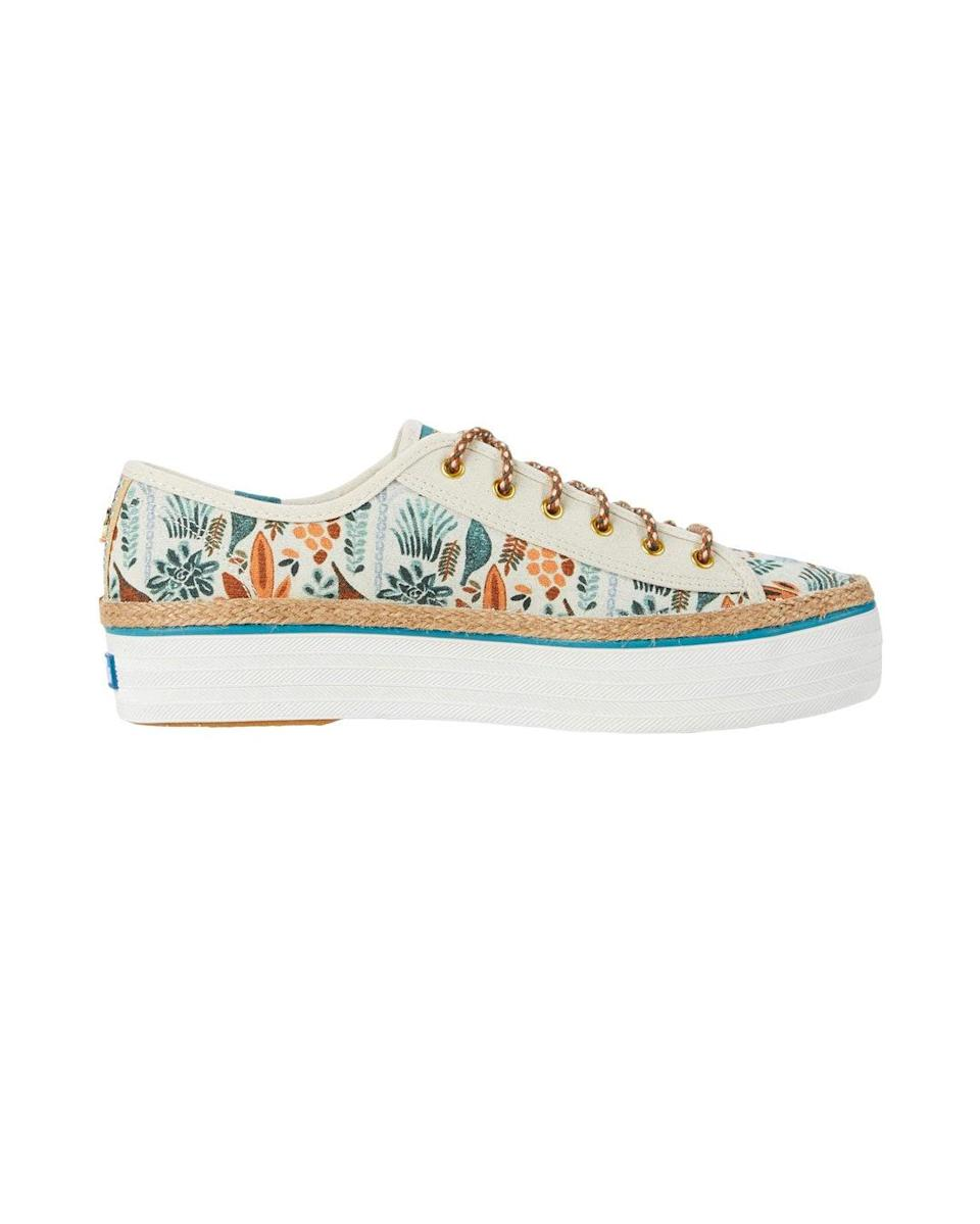 """As a lifelong member of the Crazy Plant Lady committee, I consider it a massive win any time a week goes by without adding yet another plant to my collection. So instead of spending on a new plant, I turned to these whimsical, garden-inspired kicks. They're part of Keds' latest collaboration with <a href=""""https://www.instagram.com/theJungalow/"""" rel=""""nofollow noopener"""" target=""""_blank"""" data-ylk=""""slk:The Jungalow"""" class=""""link rapid-noclick-resp"""">The Jungalow</a> founder <a href=""""https://www.instagram.com/justinablakeney/"""" rel=""""nofollow noopener"""" target=""""_blank"""" data-ylk=""""slk:Justina Blakeney,"""" class=""""link rapid-noclick-resp"""">Justina Blakeney,</a> and every time I slip them on, they prove to be the perfect quarantine pick-me-up. —<em>B.J.</em> $75, Zappos. <a href=""""https://www.zappos.com/p/keds-jungalow-x-triple-kick-rainforest-printed-canvas-natural-multi/product/9427136/color/880259"""" rel=""""nofollow noopener"""" target=""""_blank"""" data-ylk=""""slk:Get it now!"""" class=""""link rapid-noclick-resp"""">Get it now!</a>"""