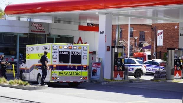 An ambulance sits at a Petro-Canada gas station on Somerset Street W. following the second stabbing on April 23, 2021.