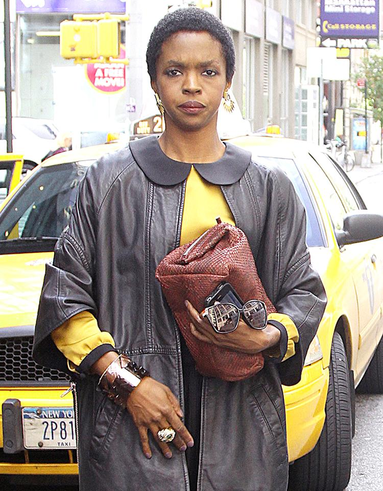 Hip Hop rapper and singer Lauryn Hill was spotted leaving her New York City hotel wearing a leather jacket with a long black dress.