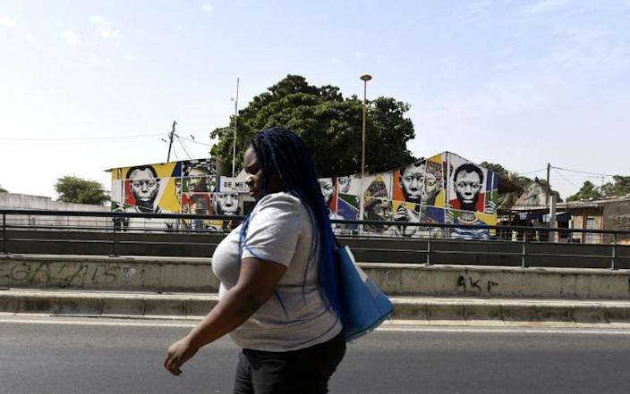 Wall murals can cause hostility as well as popularity, but the majority of local people seem to like the art (AFP Photo/SEYLLOU)