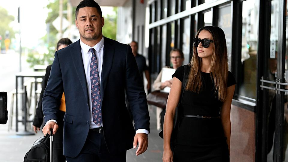 Jarryd Hayne, pictured here with his partner in December.