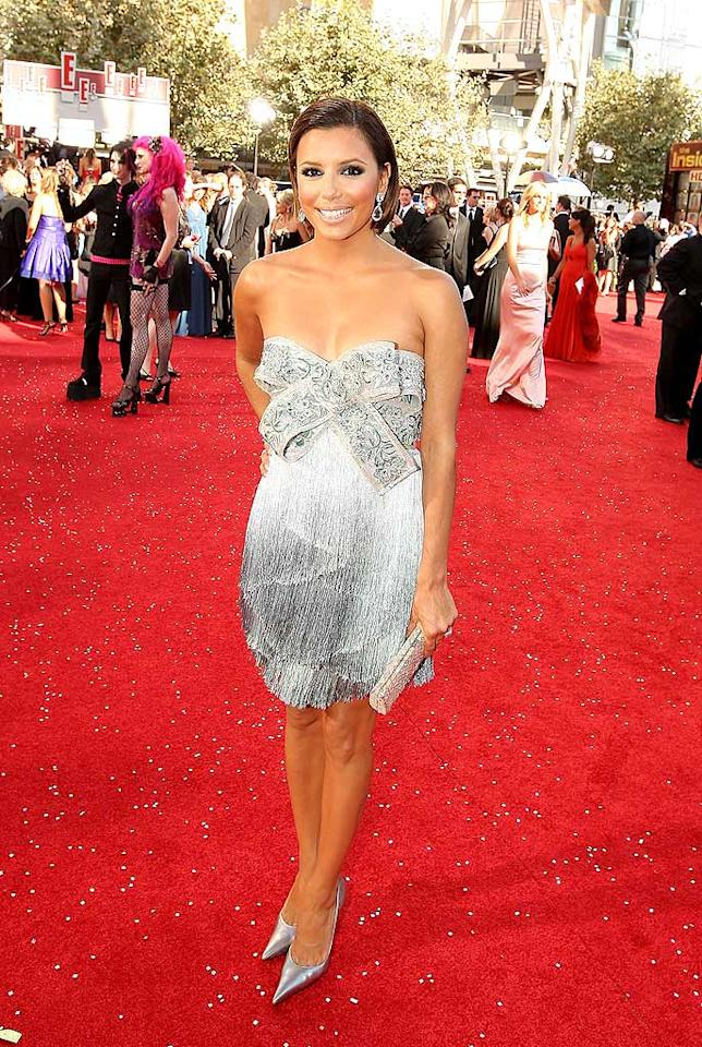 "At this year's Emmys, Eva Longoria Parker dressed as a present you wouldn't want to unwrap. Her bow-tie bomb and shortened coif were complete catastrophes. Mathew Imaging/<a href=""http://www.wireimage.com"" target=""new"">WireImage.com</a> - September 21, 2008"