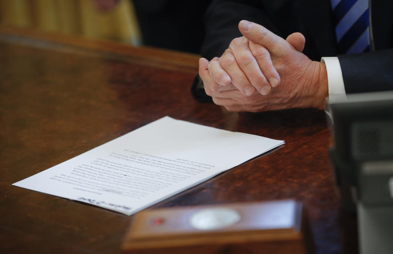President Donald Trump reads from his prepared remarks while speaking about the health care overhaul bill, Friday, March 24, 2017, in the Oval Office of the White House in Washington. (AP Photo/Pablo Martinez Monsivais)