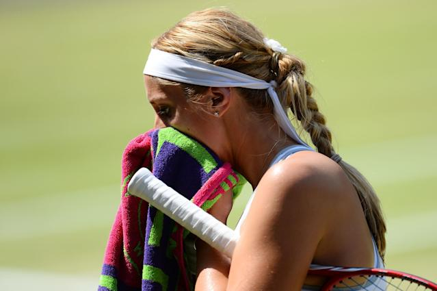 LONDON, ENGLAND - JULY 06: Sabine Lisicki of Germany wipes her face with a towel during the Ladies' Singles final match against Marion Bartoli of France on day twelve of the Wimbledon Lawn Tennis Championships at the All England Lawn Tennis and Croquet Club on July 6, 2013 in London, England. (Photo by Mike Hewitt/Getty Images)