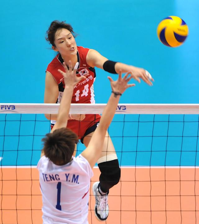South Korea's Hwang Youn-Joo (top, #14) spikes the ball over Taiwan's Teng Yen Min (bottom) during their women's volleyball qualifying tournament match for the London Olympics in Tokyo, on May 25, 2012. South Korea won the match 3-0 (25-8, 25-12, 25-18). AFP PHOTO / KAZUHIRO NOGIKAZUHIRO NOGI/AFP/GettyImages
