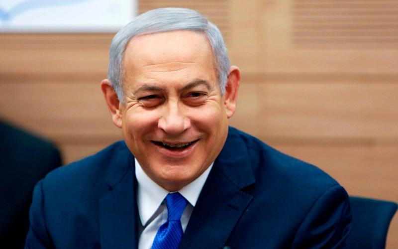 Benjamin Netanyahu appeared to call his coalition partners' bluff in a political standoff - AFP