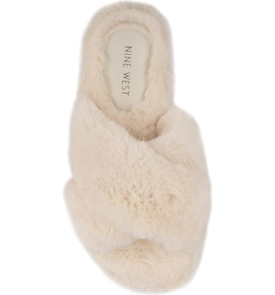 <p>Upgrade their house slippers to these decadently soft <span>Nine West Cozy Faux Fur Slipper</span> ($23, originally $39). It comes in a variety of prints and colors.</p>