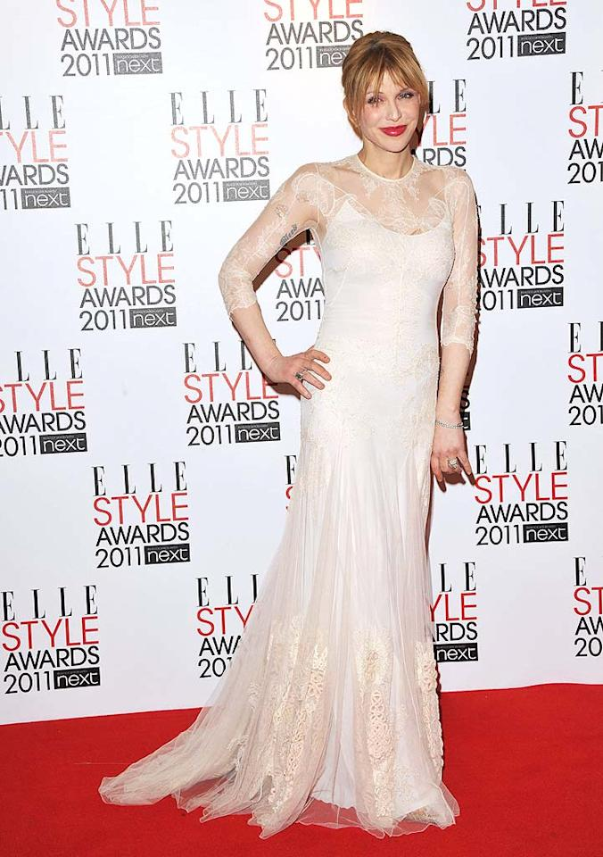 "Rocker Courtney Love looked lovely in her lace Givenchy couture gown. Jon Furniss/<a href=""http://www.gettyimages.com/"" target=""new"">GettyImages.com</a> - February 14, 2011"
