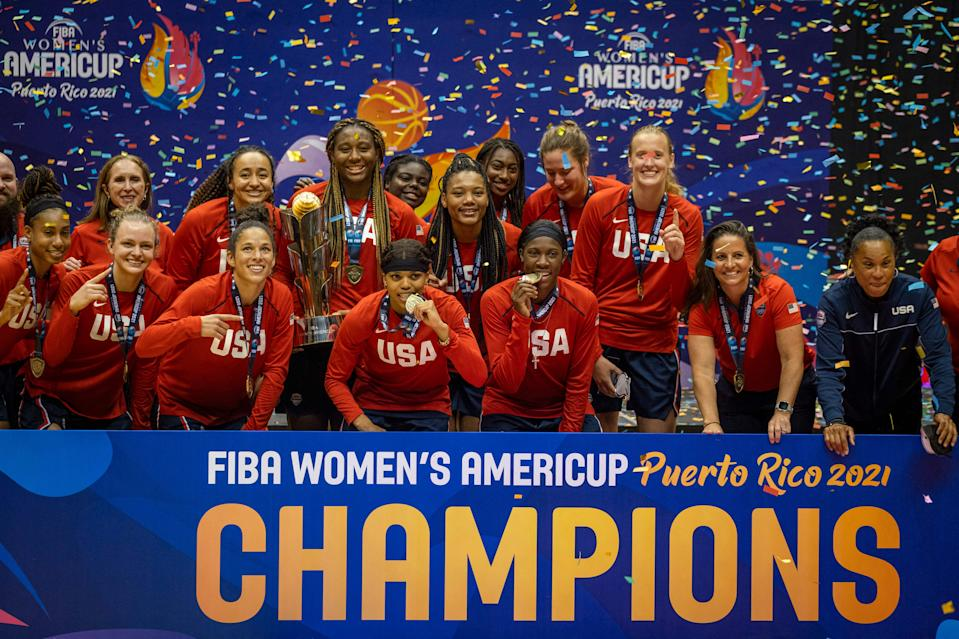 The U.S. women's basketball team celebrates its AmeriCup gold medal victory.  (Photo by RICARDO ARDUENGO/AFP via Getty Images)