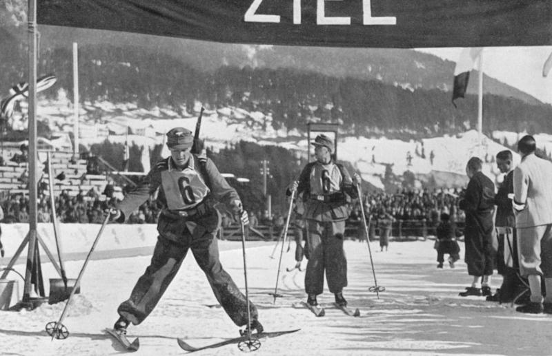 The German military ski patrol team crossing the finish line totake fifth place during the 1936 Winter Olympics in Garmisch-Partenkirchen, Germany. (Past Pix via Getty Images)