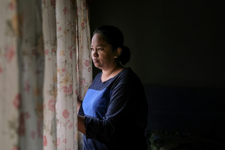 """Tilda Kalaivani, a single mother of four, was forced to stop working as a florist after the closure of all non-essential businesses and said she at first felt """"too shy"""" to hang a flag outside her home"""