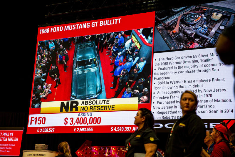 "This photo shows a sign describing the 1968 Ford Mustang ""Bullitt,"" car during the Mecum Kissimmee auction, Friday, Jan 10, 2020 in Kissimmee, Fla. The iconic Highland Green 1968 Mustang GT that once made history for its appearance in the film ""Bullitt"" is now making history again. It fetched $3.74 million Friday at Mecum's Kissimmee auction, making it the most expensive Mustang ever sold. (Patrick Connolly/Orlando Sentinel via AP)"