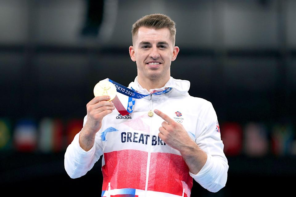 Great Britain's Max Whitlock celebrates with his gold medal after winning the men's pommel horse final in Tokyo (Mike Egerton/PA) (PA Wire)