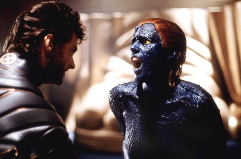 """Mystique (Rebecca Romijn-Stamos) experiences the pain of a Wolverine gut punch in 'X-Men"""" (Photo: Everett)"""