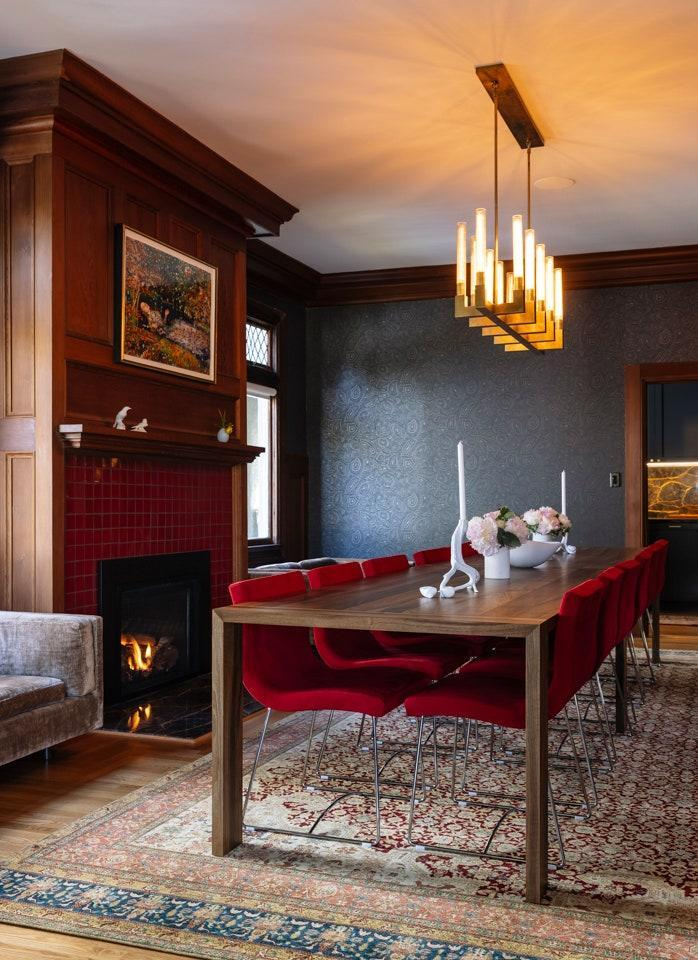 In the dining room, where the Eaton dining table and Sala dining chairs by Pascal Mourgue are all from Ligne Roset, Chakrabarti and Alataris can seat fourteen. The porcelain objects on the mantel are by Nymphenburg. The artwork above them is by Michael De Feo.