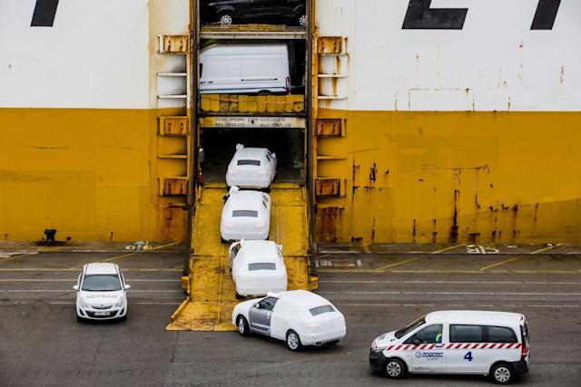 Workers drive newly manufactured Audi AG automobiles onto a Grimaldi Lines vehicle carrier during loading operations by Setram SA at the port of Barcelona in Barcelona, Spain, on Thursday, March 15, 2018. New passenger-vehicle registrations in Spain climbed 13% in February, helped by an easy comparison with a year earlier, when sales rose 0.1%. Photographer: Angel Garcia/Bloomberg