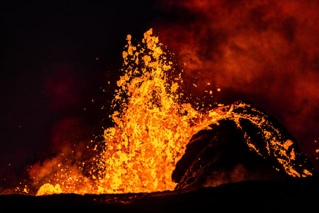 <p>Sometimes CJ shot photos after putting out fires as lava bombs crashed through the roofs of homes. (Photo: CJ Kale/Caters News) </p>