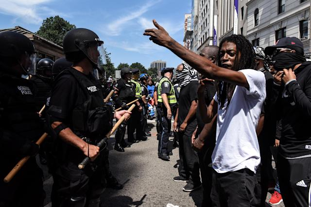 <p>A crowd of counter protesters clashes with Boston Police outside of the Boston Commons and the Boston Free Speech Rally in Boston, Mass., Aug. 19, 2017. (Photo: Stephanie Keith/Reuters) </p>
