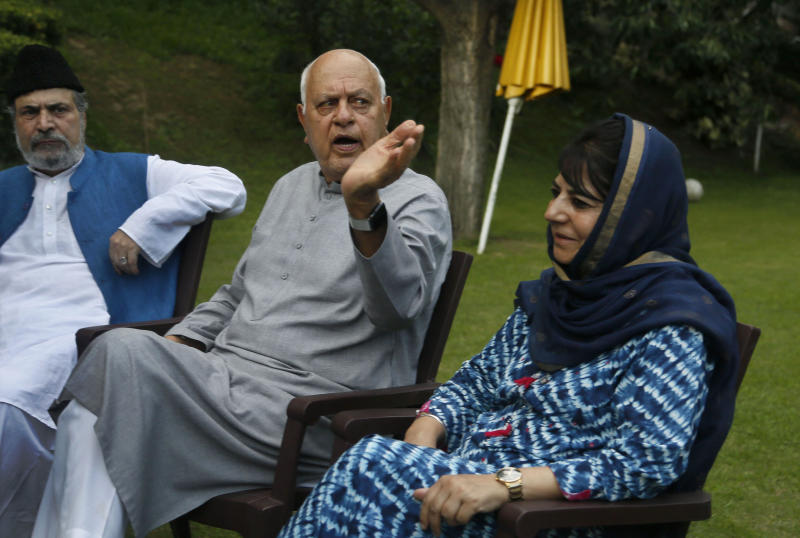 FILE - In this Aug. 4, 2019, file photo, National Conference president Farooq Abdullah, center, gestures during an all parties meeting in Srinagar, Indian controlled Kashmir. Abdullah, 81, also the former chief minister of Jammu and Kashmir, was arrested Monday under the Public Safety Act at his residence in Srinagar, the summer capital of the disputed region. (AP Photo/Mukhtar Khan, File)
