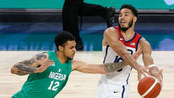 PHOTO: Michael Gbinije #12 of Nigeria knocks the ball away from Jayson Tatum #10 of the United States during an exhibition game at Michelob ULTRA Arena ahead of the Tokyo Olympic Games, July 10, 2021, in Las Vegas. (Ethan Miller/Getty Images)