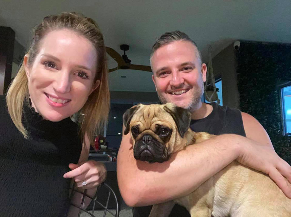 PIC BY Lauren Hill/CATERS NEWS (PICTURED Lauren with partner Brad and dog Wombat) A dog owner is speaking out after she claims her pooch was almost KILLED by a popular £2 pet chew toy – and was left with a £1,200 vet bill.  Lauren Hill spotted the bargain teething toy at Australian department store Kmart store earlier this year and thought it would be a great gift for her adorable one-year-old pug Wombat.  The 35-year-old from the Sunshine Coast in Queensland, Australia, said her dog seemed to love it and the $5AUD [£2.70] toy soon became a favourite in Wombat's collection.  But a month later, Lauren became concerned after he started vomiting for no reason - and after a panicked trip to the vet, made a shocking discovery.  Unbelievably, the plastic Kmart teething toy had allegedly broken apart and a large piece became lodged inside Wombat's stomach, which she claims made him incredibly sick. Lauren claims her vet warned that without surgery, Wombat would die – so she forked out $2,200 [£1,200] to save her beloved pet's life and thankfully, he is now fully recovered. SEE CATERS COPY.