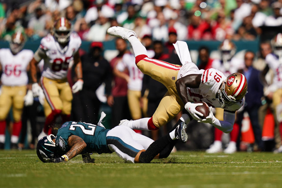 San Francisco 49ers wide receiver Deebo Samuel (19) is tackled by Philadelphia Eagles safety Marcus Epps (22) during the first half of an NFL football game Sunday, Sept. 19, 2021, in Philadelphia. (AP Photo/Matt Slocum)